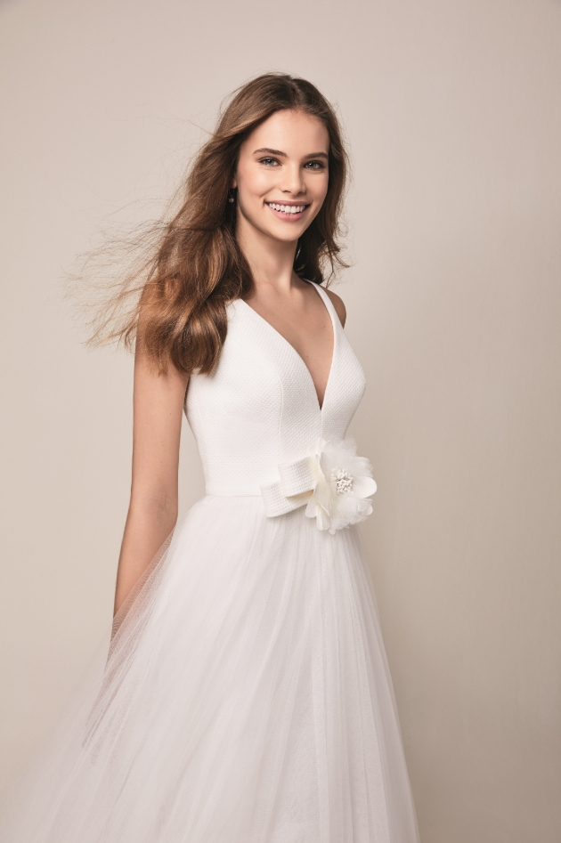 Jesus Peiro wedding dress with large floral detail on the front