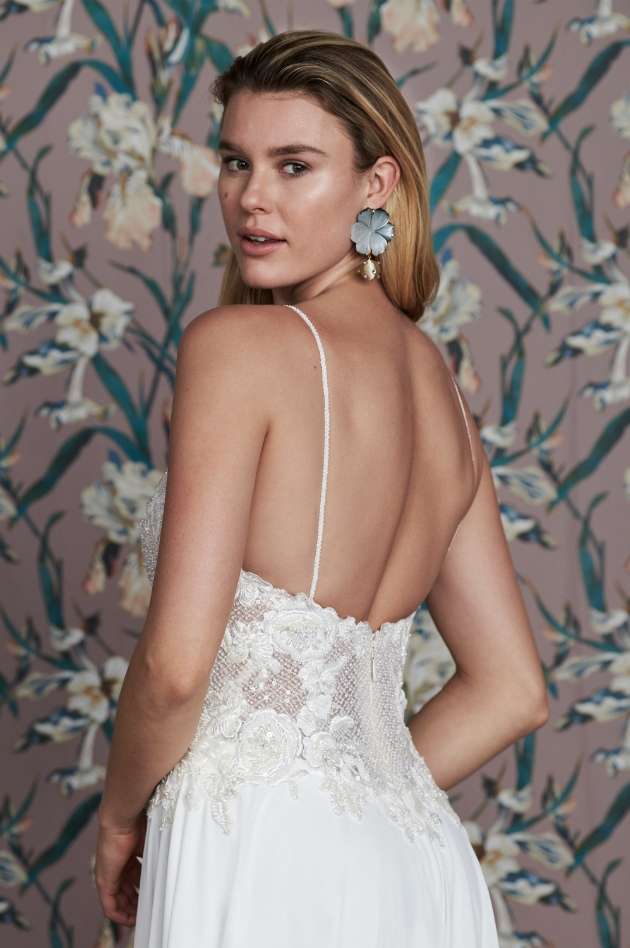 Back of model wearing wedding dress with floral corset details