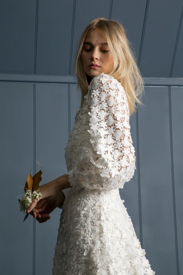Model wearing applique wedding dress