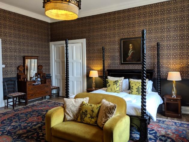 Huntsham Court, Devon, suite with four-poster bed and window