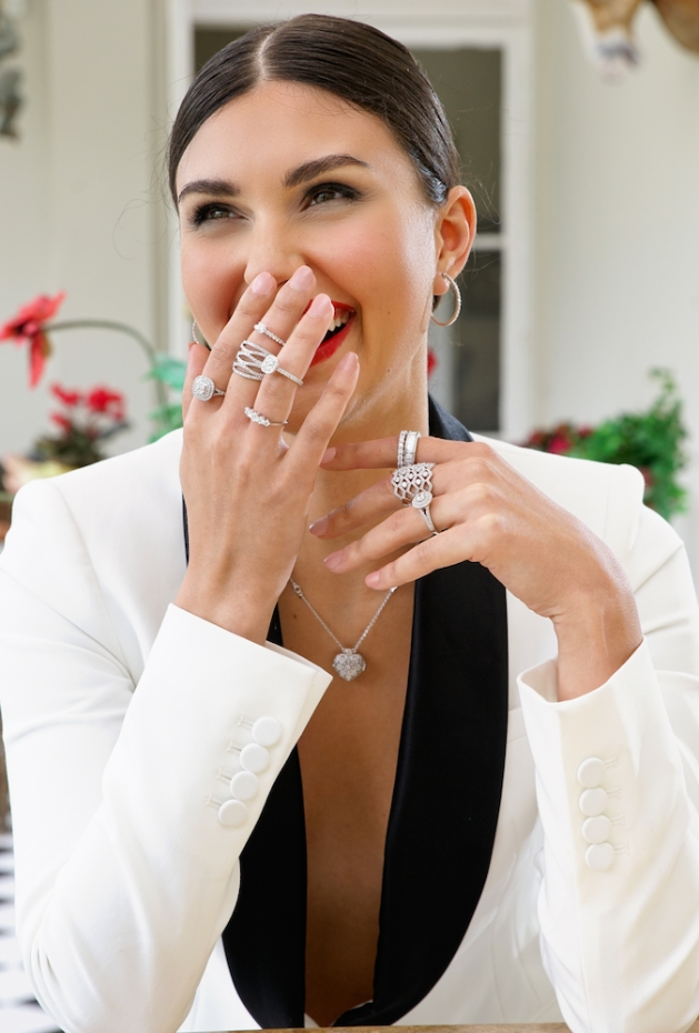Model brunette in a tux jacket covered in diamond accessories