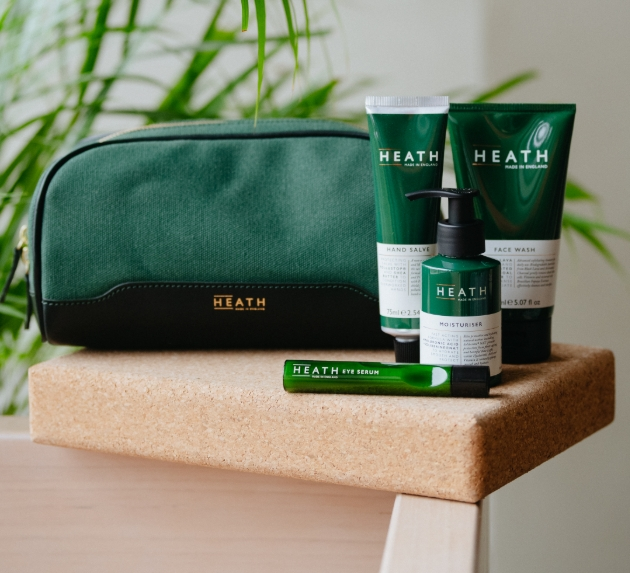 Products and washbag in green from Heath on a table