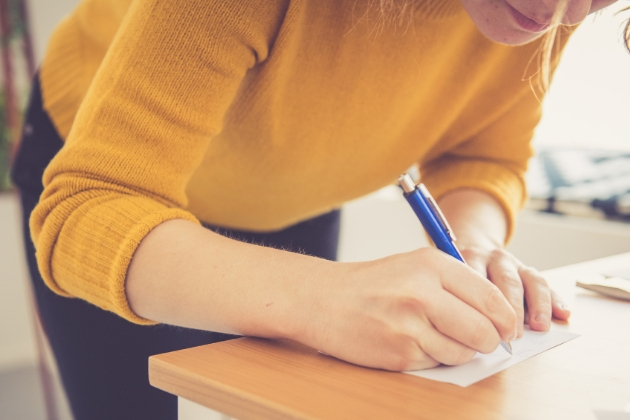 Woman writing an RSVP