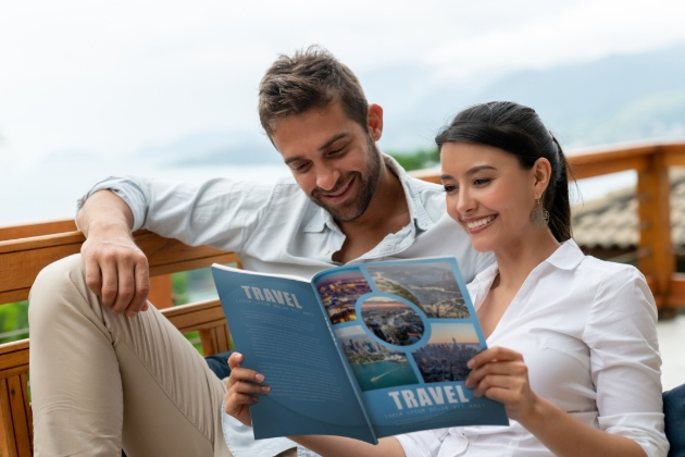 couple looking at travel mag