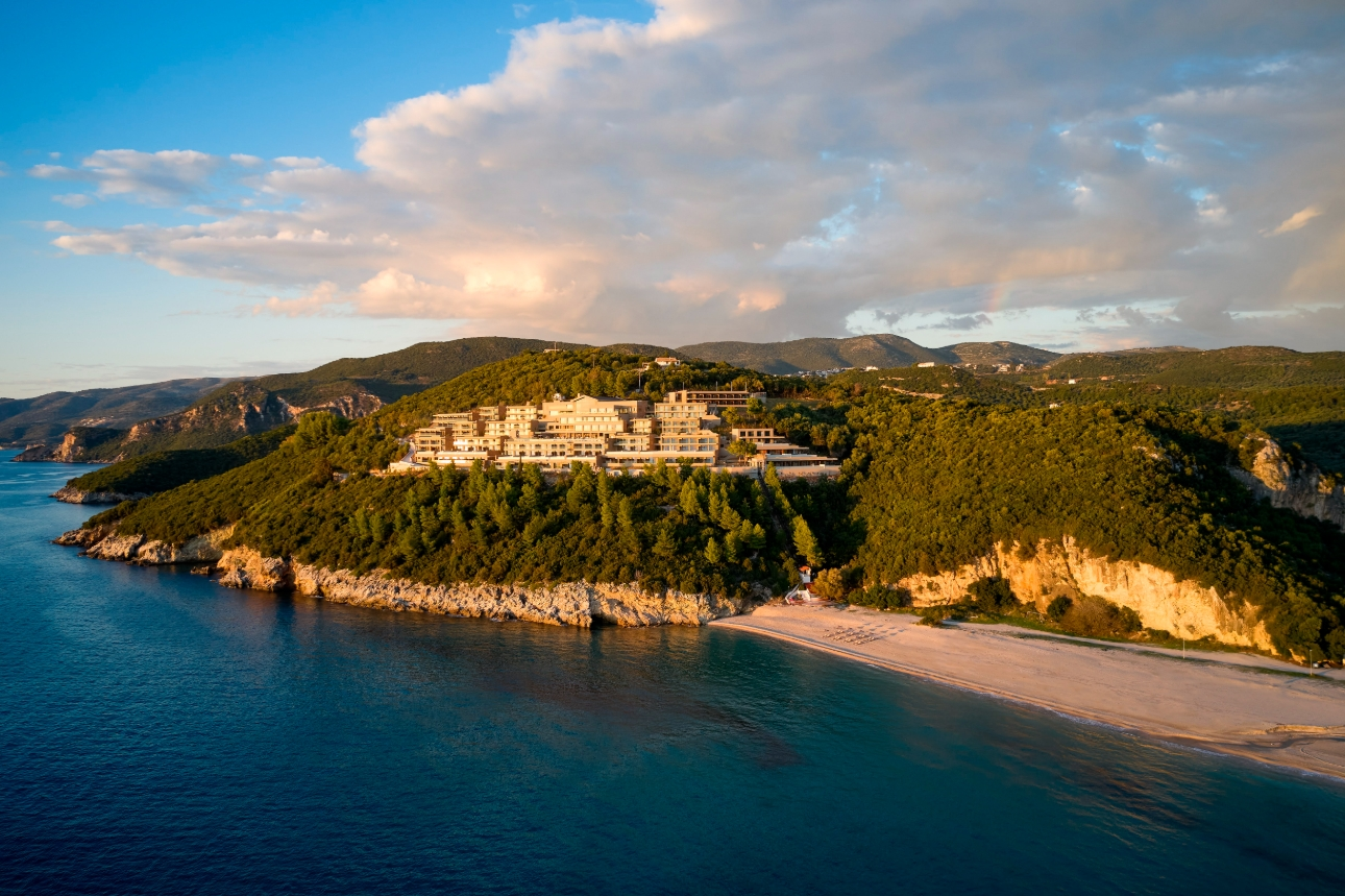 hotel perched in hills with sea and beach view