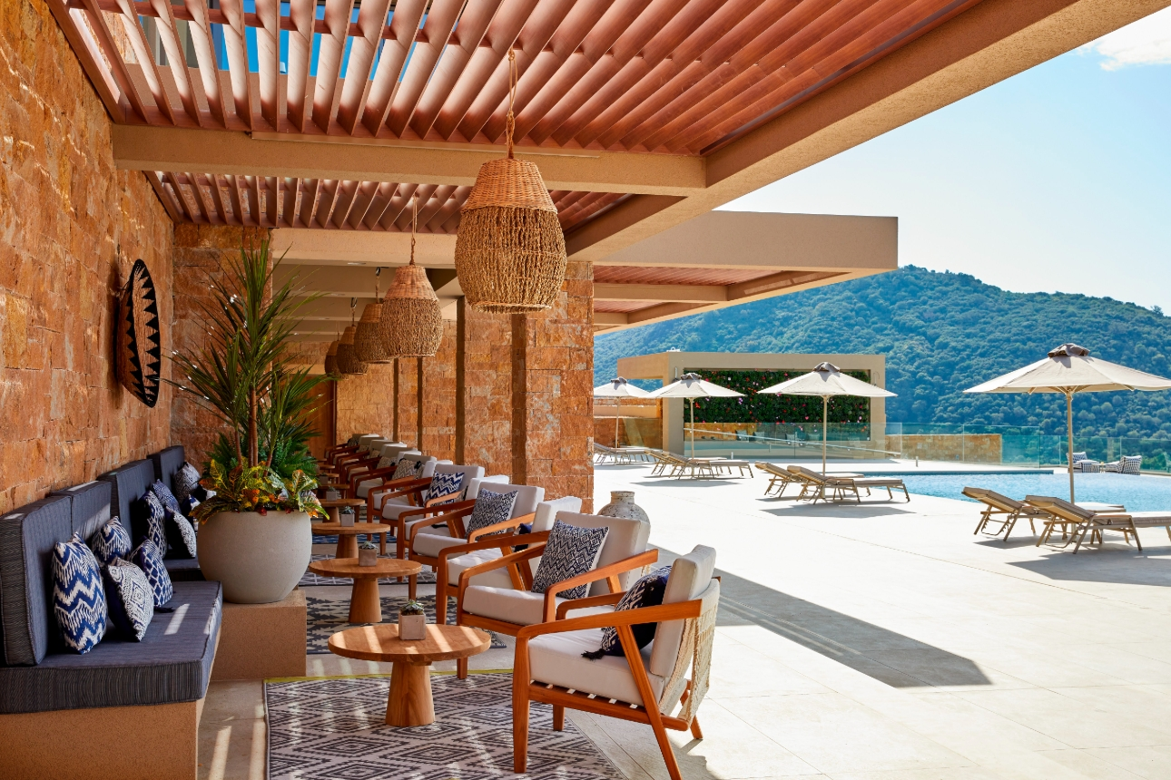 tables and chairs outside by pool