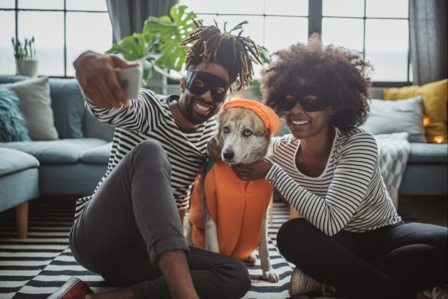 couples dressing up with their pet dog