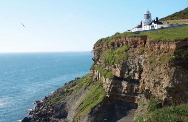 light house on edge of cliff
