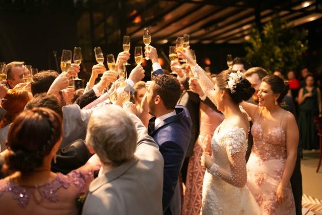 wedding party raising their glasses