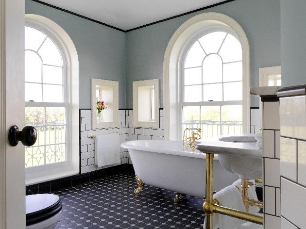 luxury bathroom large window freestanding bath white tiles