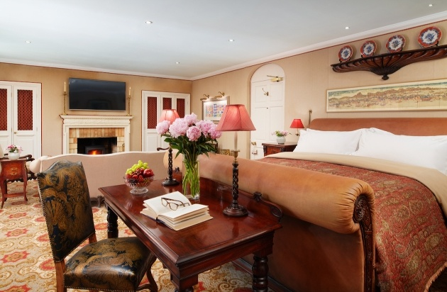 traditional suite with large bed tvs and sofas
