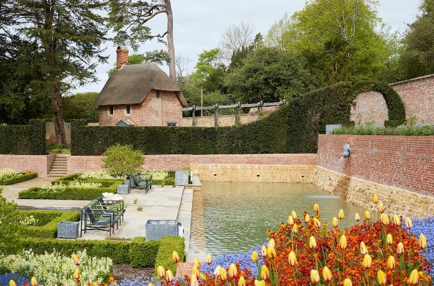 walled garden with pond and flowers