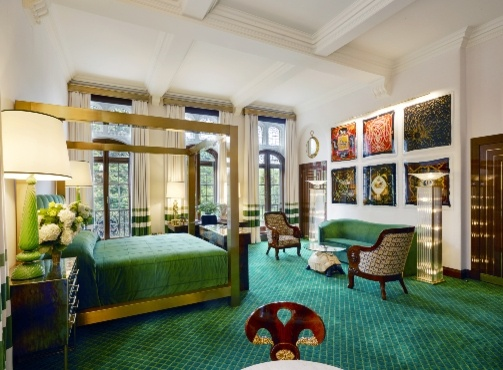 traditional suite with green furnishings and art on the walls