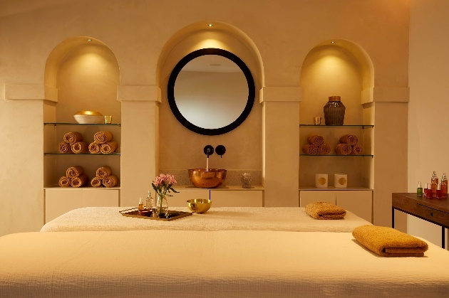 beds in a spa low lighting in room
