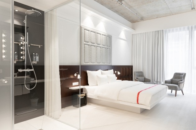 minimalistic room with show close to bed all white interior