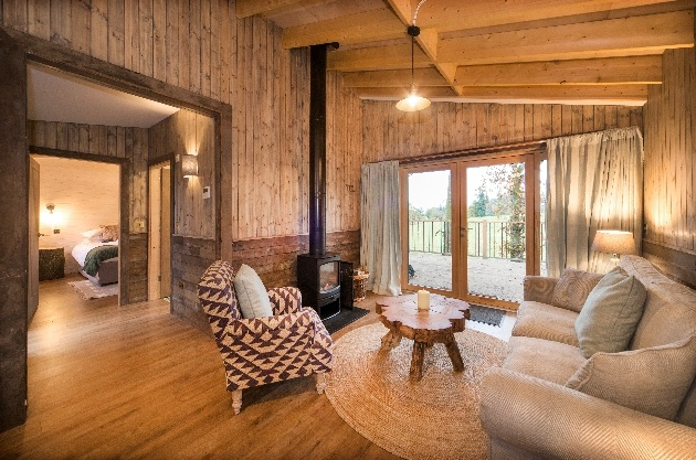 interior of treehouse with sofas and fire