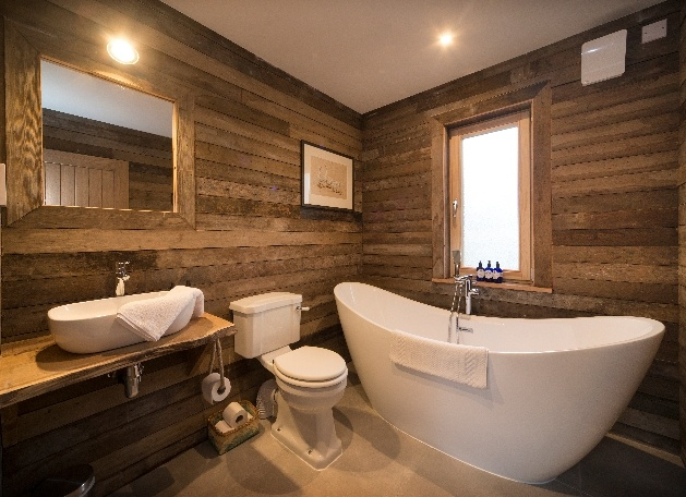 large white tub in wooded bathroom