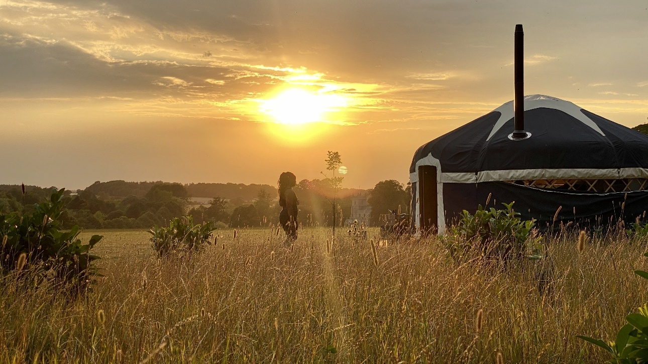 yurt at dusk in field