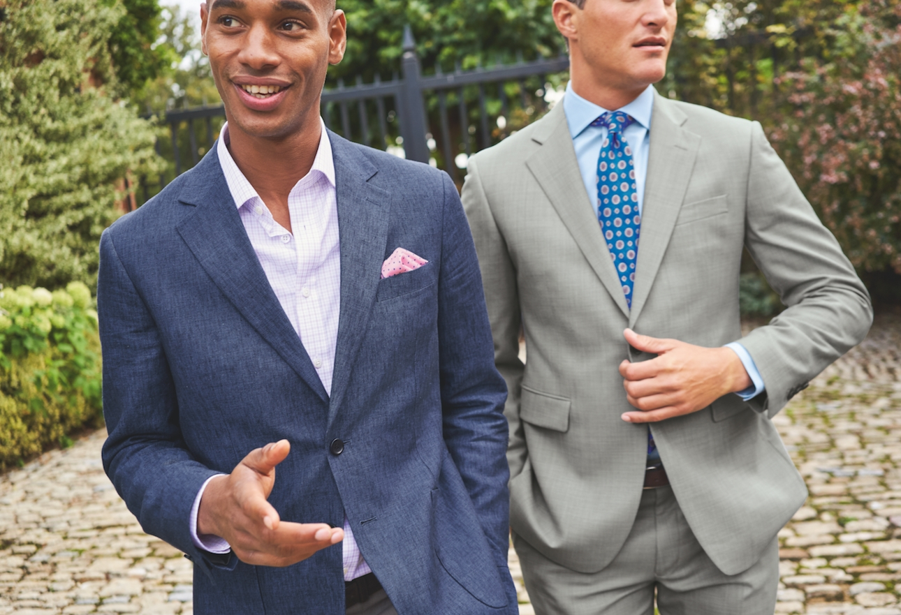 two male models in men's suit one blue one grey