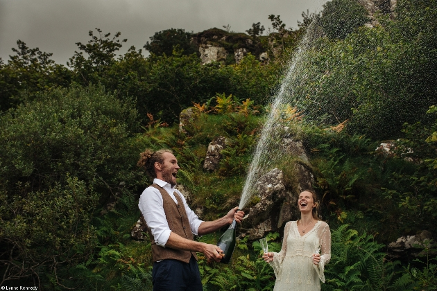 couple outdoors with a magnum of champagne