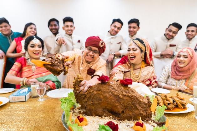 Bangladesh couple eating food at wedding
