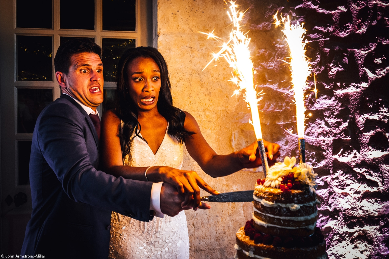 couple cutting cake with a firework in it