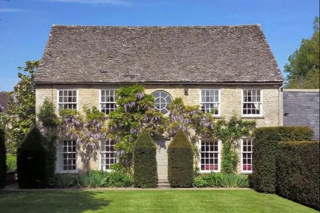 wisteria clad stone cottage lawn