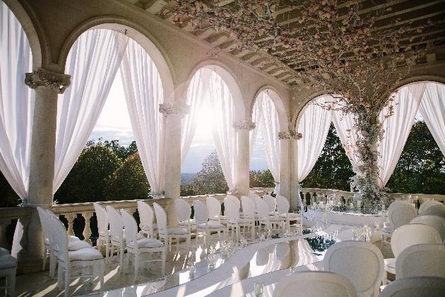 outdoor wedding on balcony flower tree floor to ceiling