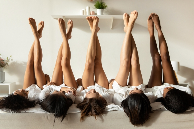 five ladies showing off their tanned legs