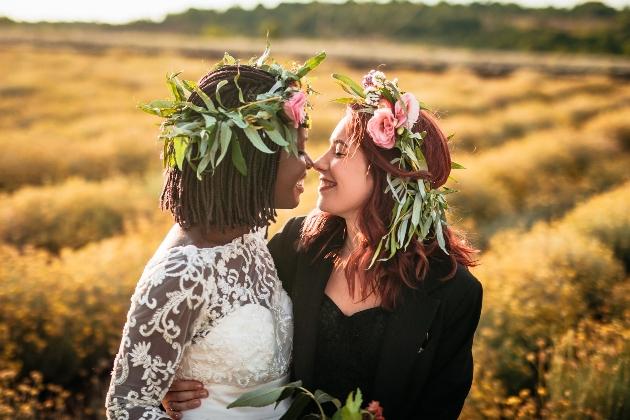 couple in field embraced