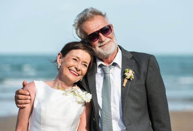 couple in wedding attire on beach