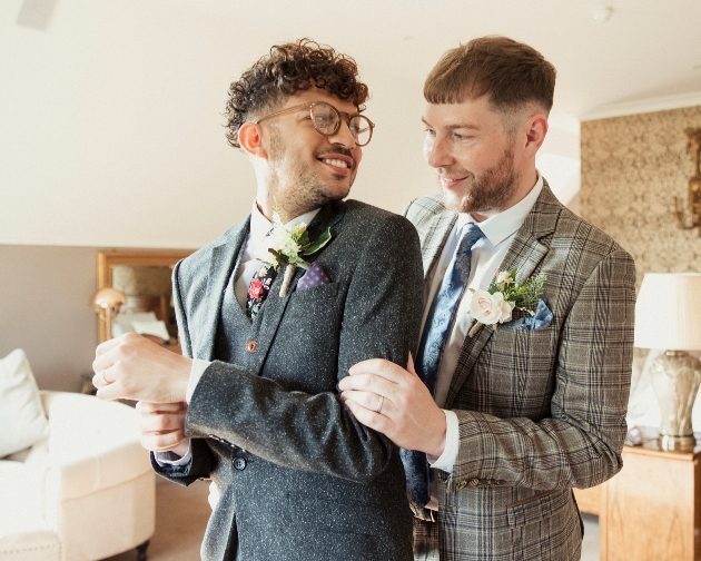 couple in suits getting married