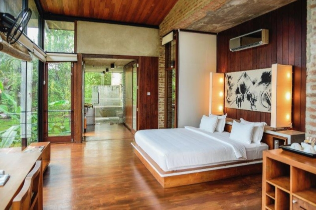 kingsize open room with wooden walls and decor and panoramic windows