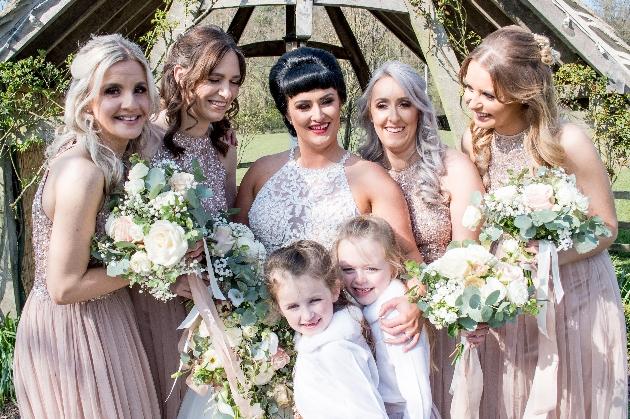 Bridesmaid pose with bride