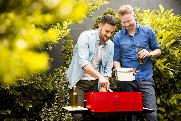 to men at barbecue in garden