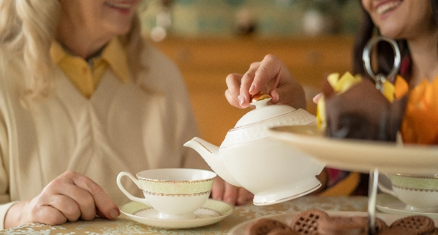 two women pouring tea in to cups